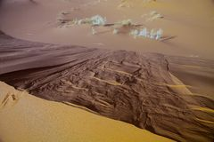 Large dunes in the Sahara deformed by the wind, Morocco Stock Photography
