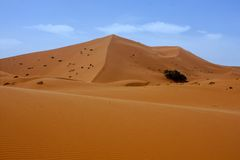 Large dunes in the Sahara deformed by the wind, Morocco Stock Photo