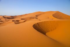 Large dunes in the Sahara deformed by the wind, Morocco Royalty Free Stock Photography