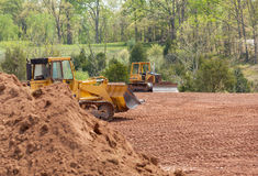 Large earth mover digger clearing land Stock Photos