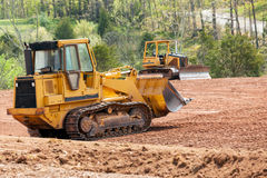 Large earth mover digger clearing land Royalty Free Stock Photo