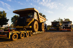 Large Earthwork Mining Trucks. Large  open cast  Trucks for Mines or earth moving infrastructure-vehicles in transit on truck trailers. Used to move huge volumes Stock Images