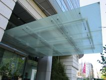 Large eaves. Large glass eaves on the building Royalty Free Stock Photo