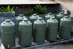 Large eco- friendly water storage tank. In suburban backyard Stock Photography