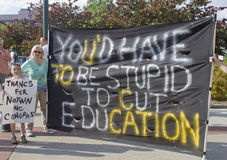 Large Education Cuts Protest Sign at Moral Monday Rally in Ashev Royalty Free Stock Images