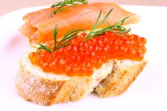 Large eggs red caviar on bread with dill Stock Photo