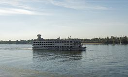 Large egyptian river cruise boat sailing on Nile. Large luxury traditional Egyptian river cruise boat sailing on the Nile stock photos