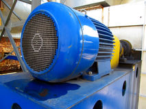 Large electric motor of blue color as the drive to the  fan Stock Photography