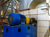 Large electric motor of blue color as the drive to the  fan Stock Photos