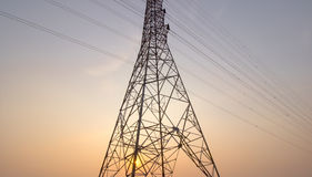 Large electricity pole. At sunset. Large electricity pole There are a number of transmission lines. At sunset Royalty Free Stock Images