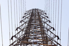 Large electricity pole There are a number of transmission lines. Large electricity pole There are a number of transmission lines View from below Stock Photos