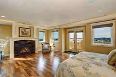 Large elegant master bedroom with fireplace. Stock Photos