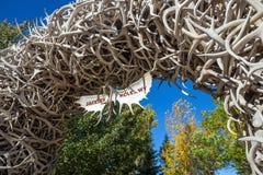 Large elk antler arches curve over Jackson Hole, Wyoming Stock Image