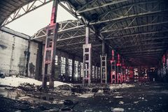 Large empty abandoned warehouse building or factory workshop, abstract ruins background stock image