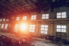 Large empty abandoned warehouse building or factory workshop royalty free stock photos