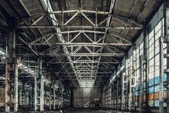 Large empty abandoned warehouse building or factory workshop stock image