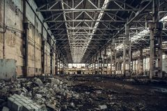 Large empty abandoned warehouse building or factory workshop stock photos