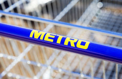 Large empty blue shopping cart Metro store Stock Images