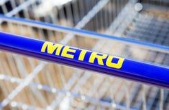 Large empty blue shopping cart Metro store Stock Images