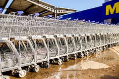 Large empty blue shopping cart Metro store Stock Photos