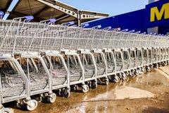Large empty blue shopping cart Metro store Stock Photos