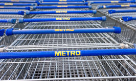 Large empty blue shopping cart Metro store Stock Image