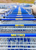 Large empty blue shopping cart Metro store Royalty Free Stock Image