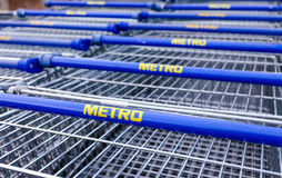 Large empty blue shopping cart Metro store Royalty Free Stock Images