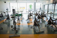 Large empty fitness studio with spin bikes Royalty Free Stock Image