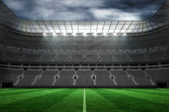 Large empty football stadium with lights Stock Images