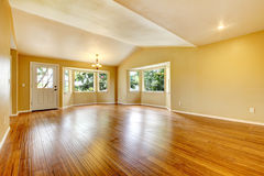 Large empty newly remodeled living room with wood floor. Large empty newly remodeled living room with wood floor and front door Royalty Free Stock Photo