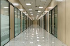 Large empty office corridor interior stock photo