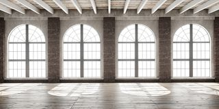 Large empty room in loft style. With big arched windows illuminated by sunlight. Interior mock up with wooden floor and brick wall. 3D render Royalty Free Stock Images
