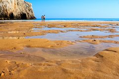 Large, empty sandy beach in Portugal royalty free stock photography