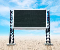Large empty sign board on sand with sky Royalty Free Stock Photos