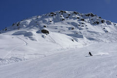Ski run and lone skier, San Pellegrino pass Stock Image