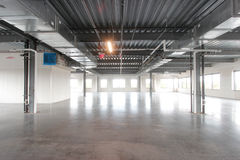 Large empty warehouse space. New empty office space, apartment room, modern business hall Royalty Free Stock Photo