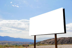 A large, empty, white advertising sign in the countryside Royalty Free Stock Images