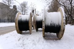 Large empty wooden coils The new cable drums at the industrial area. Outdoors stock images
