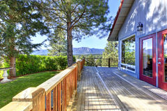 Large empty wooden deck of blue house in Cle Elum. Royalty Free Stock Photo