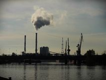 A large enterprise on the river. Large companies that pollute the air and water Stock Images