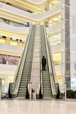 Large escalator in modern plaza hall Stock Image