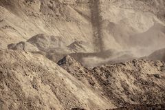 Large excavation site with heaps of sand Royalty Free Stock Photography