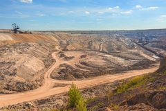 Large excavation site with roads ahead. At day stock images