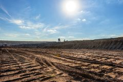 Large excavation site with roads ahead. At day royalty free stock images