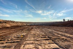 Large excavation site with roads ahead. At day stock image