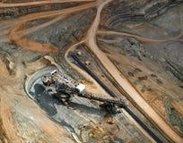 Large excavator in coal mine, aerial. Large excavator in surface coal mine, aerial view stock photo