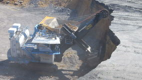 A large excavator loads