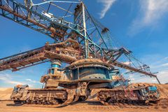 Large excavator machine in the mine Stock Images