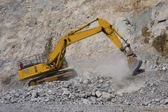 Yellow excavator in a mine. royalty free stock image